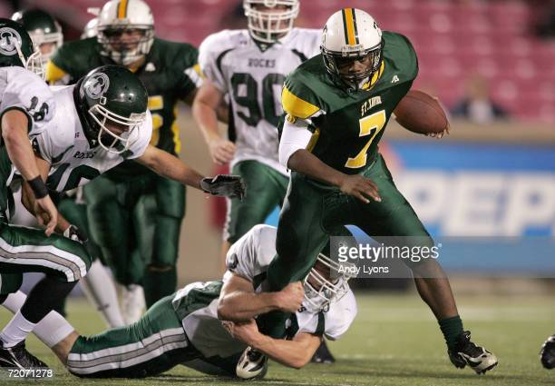 Duece Finch of the St Xavier Tigers runs the ball against the Trinity Shamrocks during their regular season High School football game September 22...
