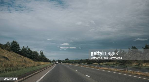 duel carriageway in the uk - driving stock pictures, royalty-free photos & images