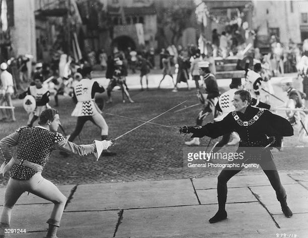 A duel scene from the film version of Shakespeare's 'Romeo And Juliet' featuring Reginald Denny and Basil Rathbone as Benvolio and Tybalt The film...
