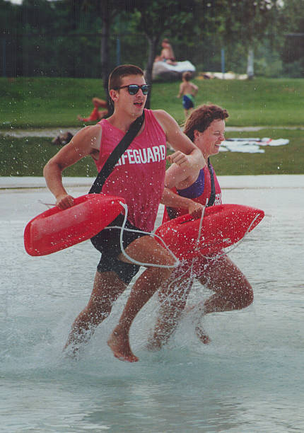 duelling lifeguards head lifeguard kim gray right and colleague steve king make a