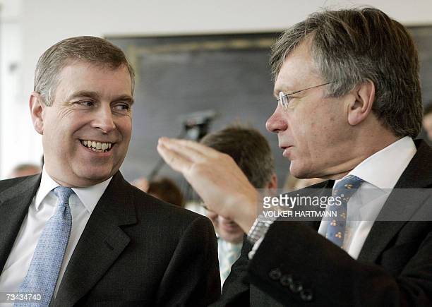"""Britain's Prince Andrew speaks with British ambassador Peter Torry at a congress from the British business development group """"UK Trade and..."""