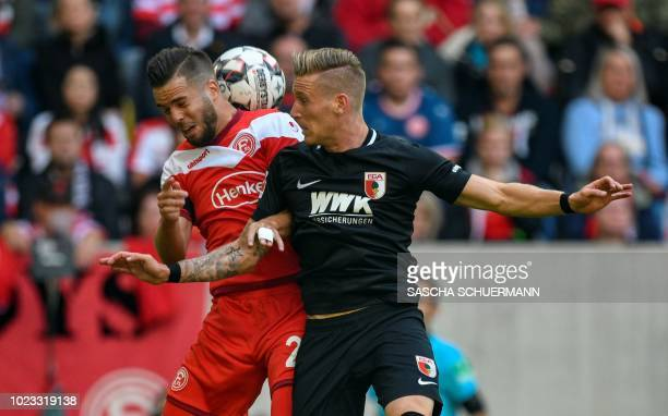 Duesseldorf's defender Niko Giesselmann and Augsburg's midfielder Andre Hahn vie for the ball during the German first division Bundesliga football...