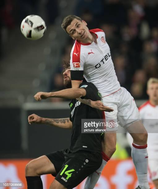 Duesseldorf's Marcel Sobottka and Martin Harnik of Hanover fight for the ball during the German Bundesliga soccer match between Fortuna Düsseldorf...