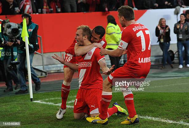 Duesseldorf's striker Thomas Broeker and his teammates celebrate during the football relegation match for Germany's first division Bundesliga between...
