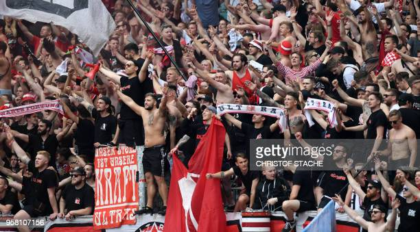 Duesseldorf's supporters celebrate after the German second division Bundesliga football match 1 FC Nuremberg vs Fortuna Duesseldorf in Nuremberg...