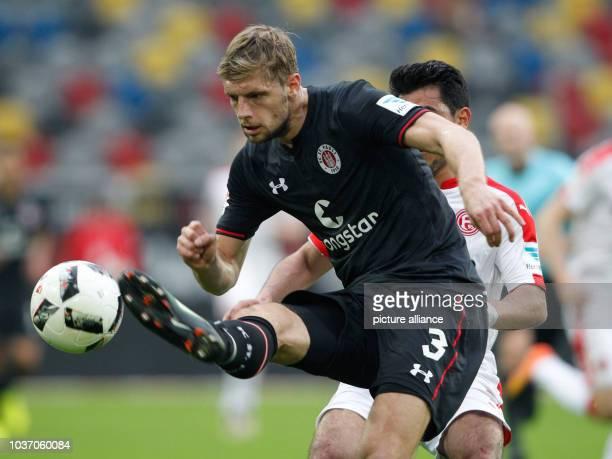 Duesseldorf's Özkan Yildirim and Lasse Sobiech of St Pauli vie for the ball during the German Bundesliga seconds match between Fortuna Duesseldorf...