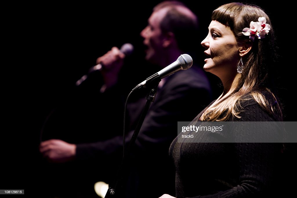 Duet between a male and female vocalist live on stage : Stock Photo