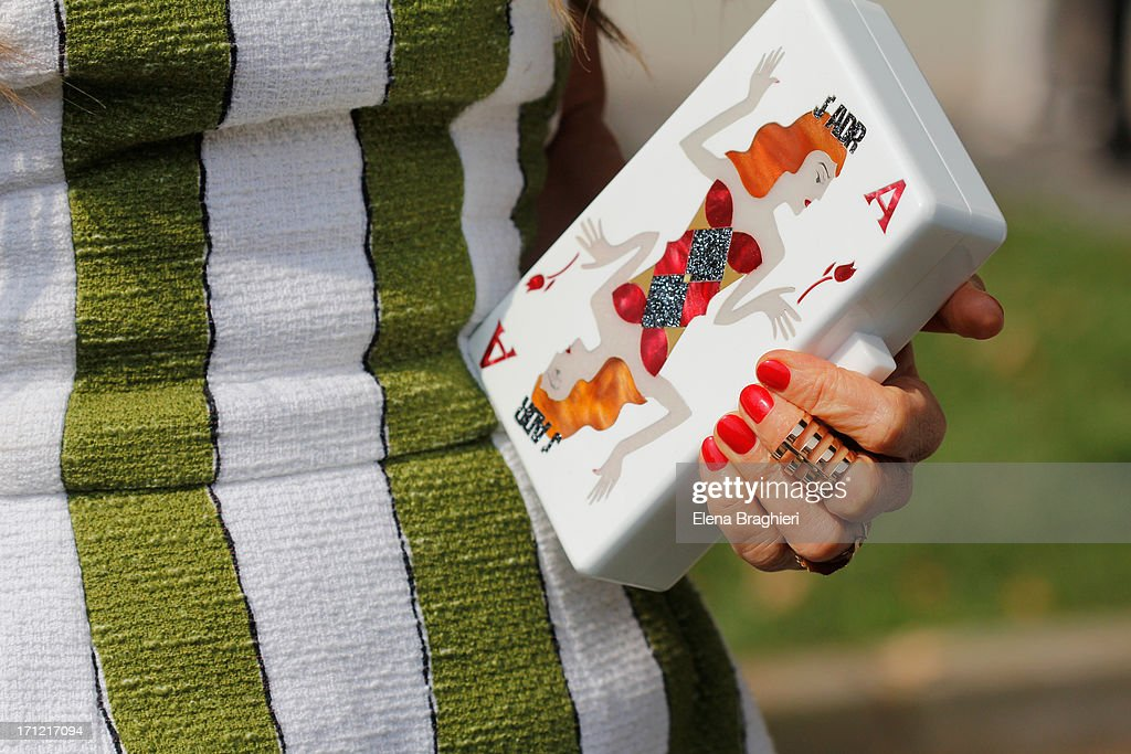 duFashion editor Anna Dello Russo is seen at Milan Men's Fashion Week on June 22nd, 2013 in Milan, Italy. Detail of Urania Gazelli clutch.