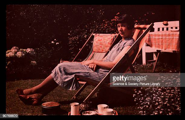 Dufaycolor colour transparency of a woman sitting in a deckchair in a garden taken by an unknown photographer in about 1940 The Dufaycolor process...