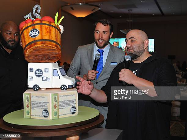 Duff Goldman examines the winner cake prepared by Melissa Payne of Couture Cake Creations during the DC Central Kitchen's Capital Food Fight event at...