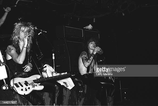 Duff McKagan and Axl Rose of Guns N Roses perform at L'Amour on October 29 1987 in the Brooklyn borough of New York City