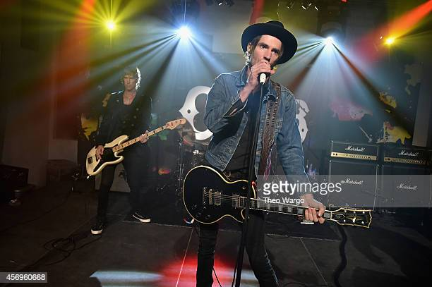 Duff McKagan and Jeff Angell of Walking Papers perform onstage at CBGB Music Film Festival 2014 HQ Kickoff event with Keynote Speaker Billy Idol on...