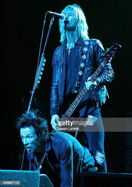 Duff McKagan and Scott Weiland of Velvet Revolver perform at the Gibson Amphitheater on December 12 2007 in Los Angeles California