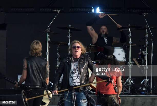 Duff McKagan, Axl Rose, Frank Ferrer and Slash of Guns 'N' Roses performs at Donington Park on June 9, 2018 in Donington, England.