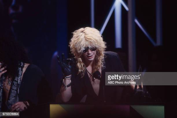 Duff McKagan Guns N' Roses receiving award on the 17th Annual American Music Awards Shrine Auditorium January 22 1990
