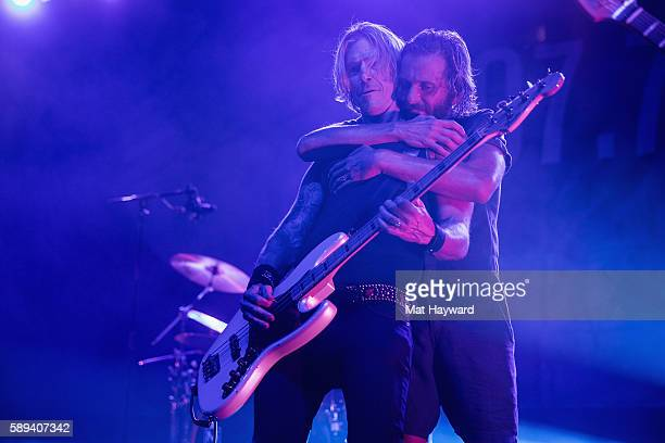 Duff McKagan of Guns and Roses performs with Aaron Bruno of Awolnation on stage during the 1077 The End Summer Camp music festival at Marymoor Park...