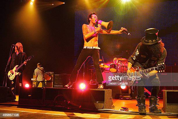 Duff McKagan Scott Weiland and Slash of Velvet Revolver performs at the Gibson Amphitheater on December 12 2007 in Los Angeles California