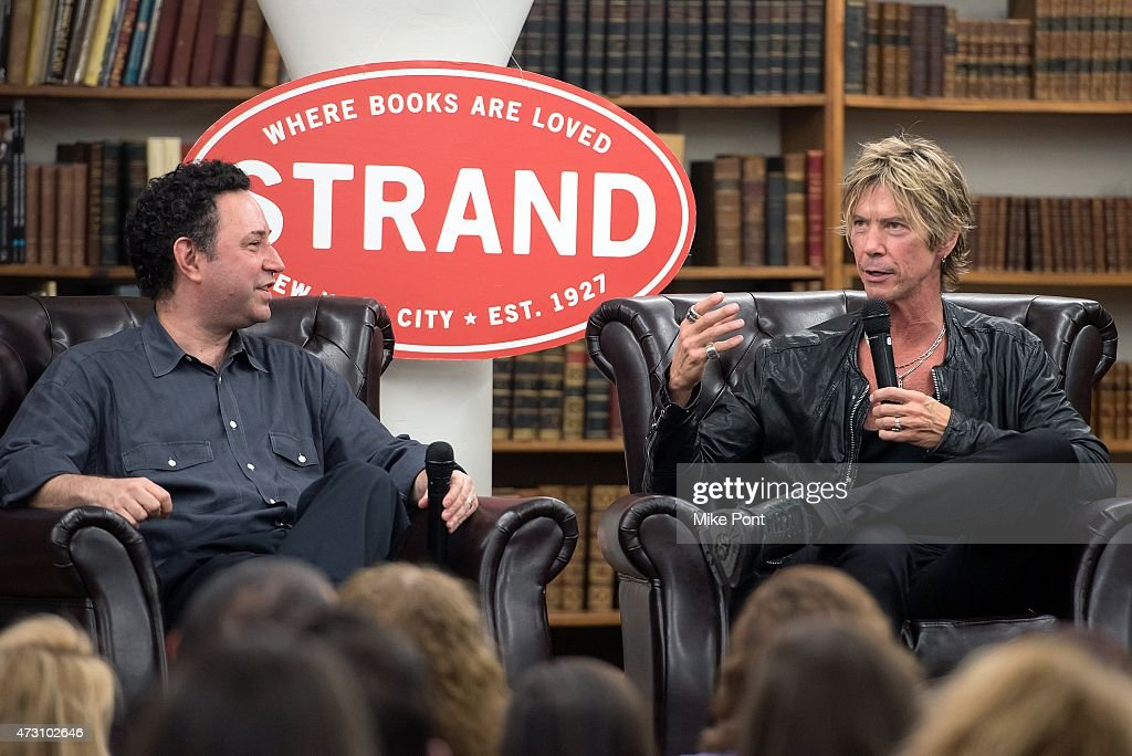 Duff McKagan (R) signs copies of 'How To Be A Man' at Strand Bookstore on May 12, 2015 in New York City.