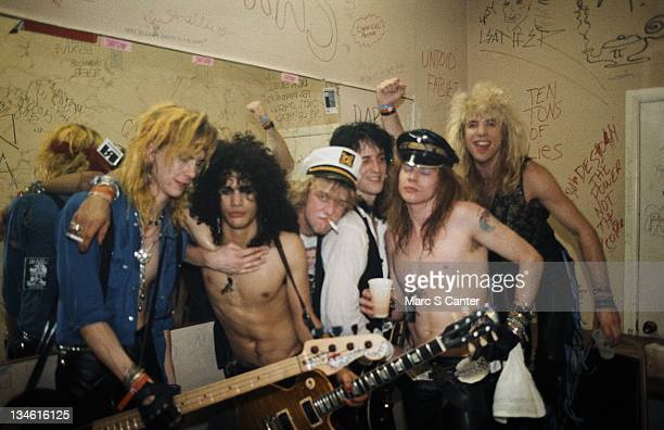 Duff McKagan, Slash, Izzy Stradlin, Axl Rose and Steven Adler of the rock group 'Guns n' Roses' pose for a portrait backstage on a night when they...