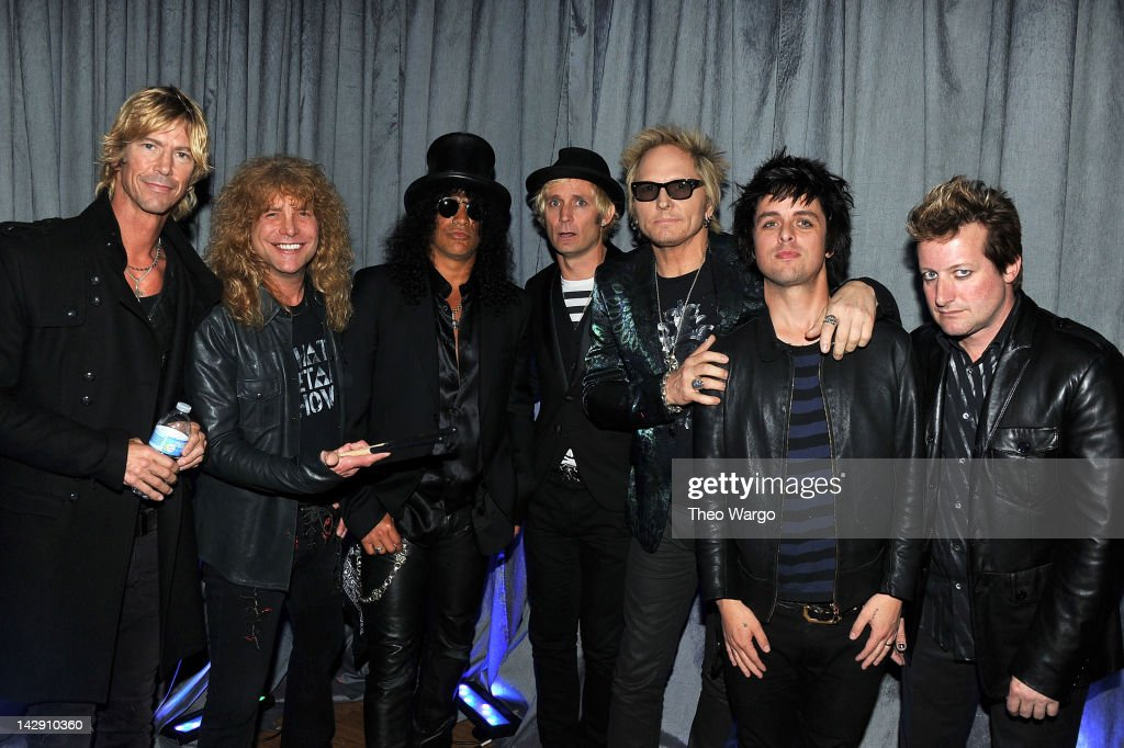 Duff McKagan, Steven Adler, Slash of Guns N' Roses poses with Mike Dirnt of Green Day, Matt Sorum of Guns N' Roses, Billie Joe Armstrong and Frank Wright 'Tre Cool' of Green Day at the 27th Annual Rock And Roll Hall Of Fame Induction Ceremony at Public Hall on April 14, 2012 in Cleveland, Ohio.