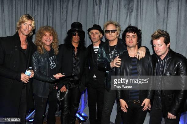 Duff McKagan, Steven Adler, Slash of Guns N' Roses poses with Mike Dirnt of Green Day, Matt Sorum of Guns N' Roses, Billie Joe Armstrong and Frank...