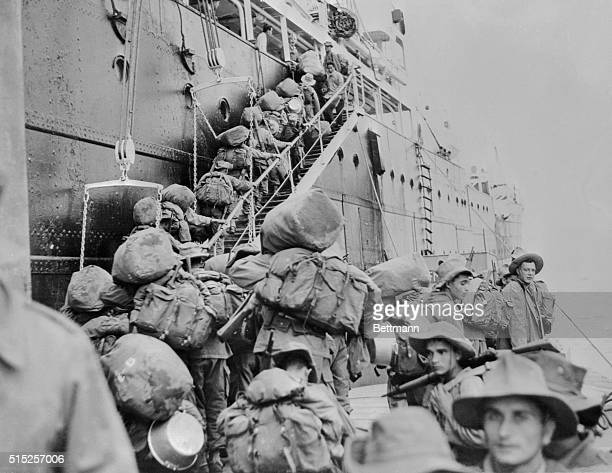 Duffle bags on their backs French soldiers of the Seventh Algerian Rifle Regiment board a transport at Tourane bound for Algeria and home From the...