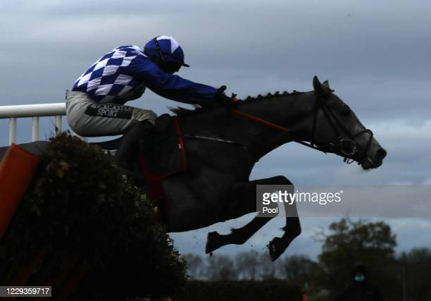 Duffle Coat ridden by Jonathan Burke clear a fence before winning the Weatherbys Hamilton Wensleydale Juvenile Hurdle at Wetherby Racecourse on...