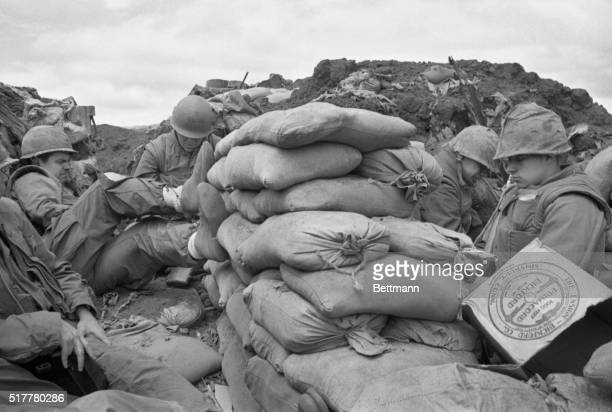 Dug in at Khe Sanh Khe Sanh South Vietnam Trench warfare is a novel role for the US Marines but continuous bombardment and the expectation of a...