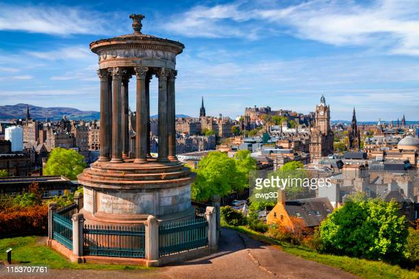 dugald stewart monument and view over historic edinburgh from calton hill, scotland, uk - edinburgh castle stock pictures, royalty-free photos & images