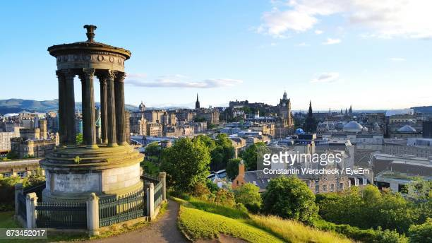 dugald stewart monument in town against sky - edinburgh scotland stock pictures, royalty-free photos & images