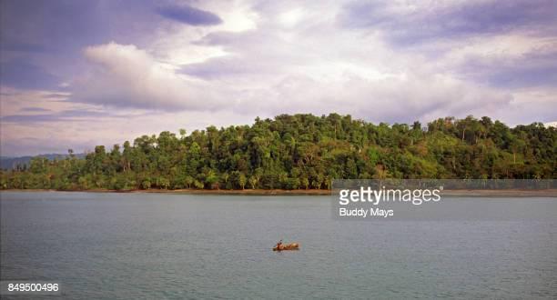 Dugout Canoe and Fisherman