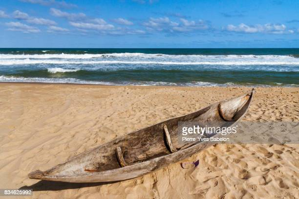 dugout canoe beached - dugout canoe stock photos and pictures
