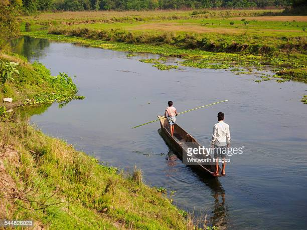 dugout canoe on river in chitwan, nepal - terai stock pictures, royalty-free photos & images