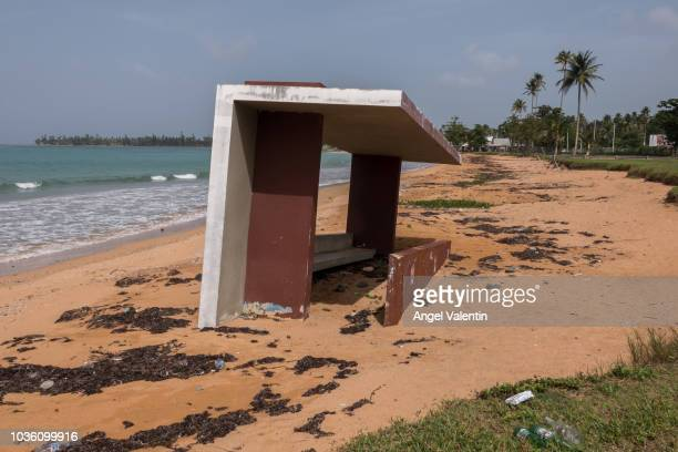 A dugout from a baseball park is partially sunken on the sand of the Luquillo Beach a victim of beach surge caused by Hurricane Maria on September 19...