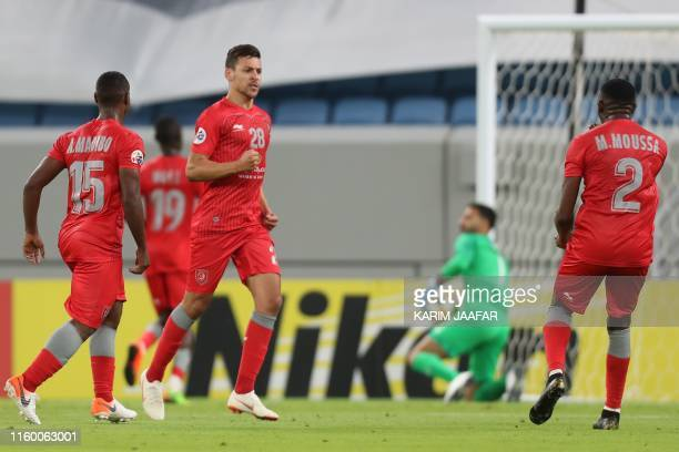 Duhail's midfielder Youssef Msakni celebrates his equalising goal during the AFC Champions League play-off football match between Qatar's al-Duhail...