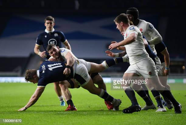 Duhan van der Merwe of Scotland breaks past Mark Wilson of England to score his sides first try during the Guinness Six Nations match between England...