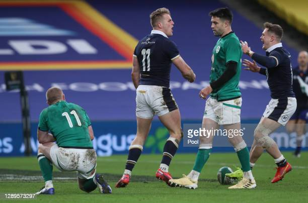 Duhan van der Merwe of Scotland celebrates after scoring their first try as Conor Murray of Ireland looks dejected during the Autumn Nations Cup...