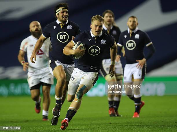 Duhan van der Merwe of Scotland makes a break to score his sides 5th try after being fed a pass from Finn Russell during the warm up match between...
