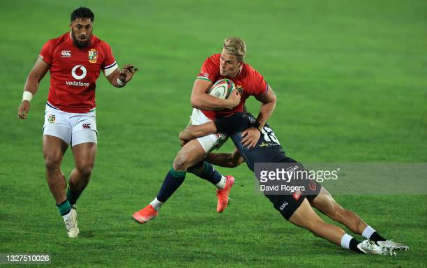 Duhan van der Merwe of The British and Irish Lions is tackled by Jeremy Ward of Cell C Sharks during the Cell C Sharks v British & Irish Lions tour...