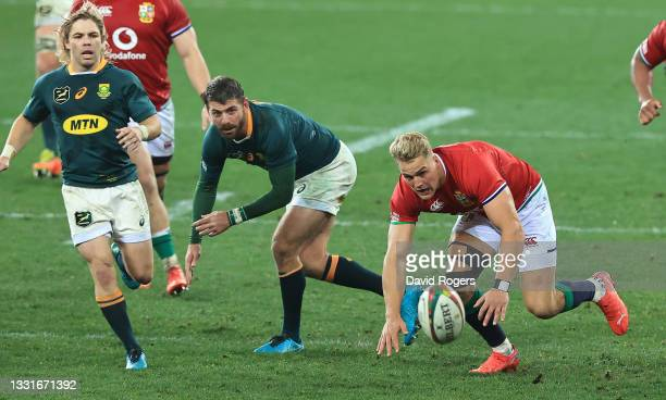 Duhan van der Merwe of the Lions races with Willie le Roux to gather the loose ball during the 2nd test match between South Africa Springboks and the...