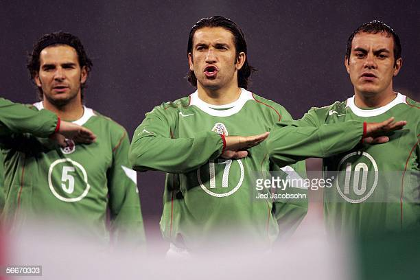 Duilio Davino Francisco Fonseca and Cuauhtemoc Blanco of Mexico listen to the Mexican anthem before the Mexico v Norway friendly soccer match on...