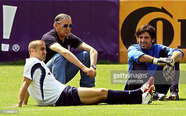 Italian captain Fabio Cannavaro team manager Gigi Riva and goalkeeper Gianluigi Buffon are seen during a training session 08 July 2006 in Duisburg on...