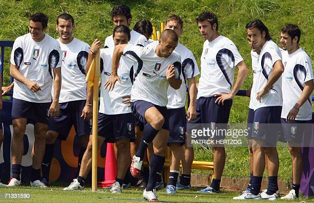 Italian captain Fabio Cannavaro warms up in front of his teammates during a training session 30 June 2006 in Duisburg, on the eve of their quarter...