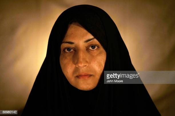 Dujail widow Amal Abed al Hadi Hamdi poses for a photograph on October 20 2005 in Dujail Iraq Her husband Hamed Abass Hasson was a 29yearold primary...