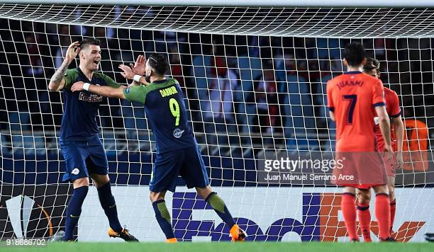 Duje CaletaCar of FC Red Bull Salzburg celebrates after scoring the first goal for FC Red Bull Salzburg during UEFA Europa League Round of 32 match...