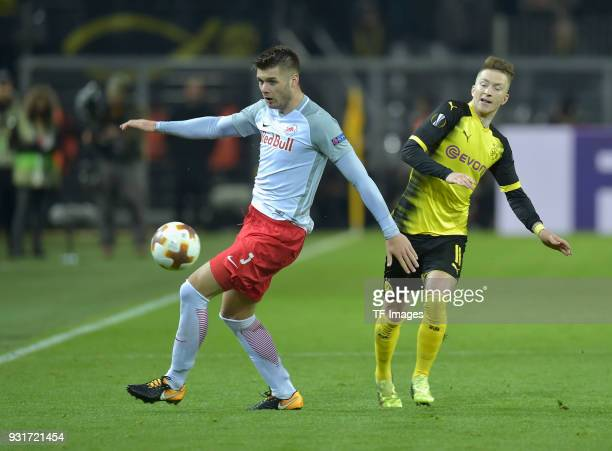 Duje CaletaCar of Salzburg and Marco Reus of Dortmund battle for the ball during UEFA Europa League Round of 16 match between Borussia Dortmund and...