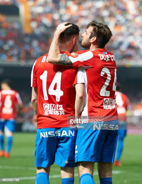 Duje Cop and Jorge Franco Burgui of Real Sporting de Gijon celebrates their goal during their La Liga match between Valencia CF and Real Sporting de...