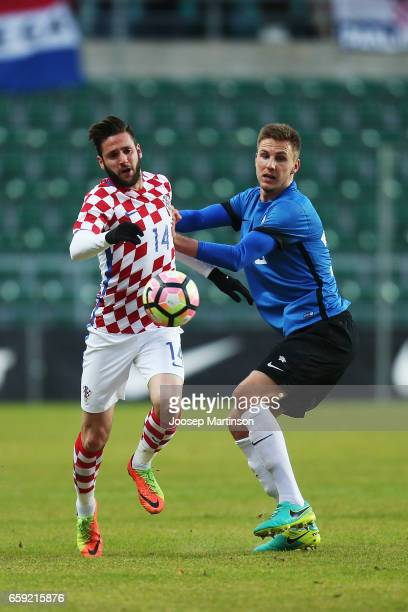 Duje Cop of Croatia competes with Karol Mets of Estonia during international friendly between Estonia and Croatia at A le Coq Arena on March 28 2017...