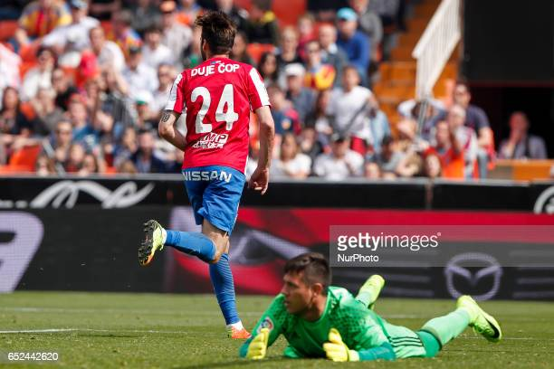 24 Duje Cop of Real Sporting de Gijon celebrate after scoring the 01 goal in the face of 01 Diego Alves of Valencia CF during the Spanish La Liga...