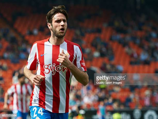 Duje Cop of Real Sporting de Gijon celebrates after scoring a goal during the La Liga match between Valencia CF and Real Sporting de Gijon at...